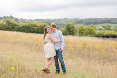 Couple kissing on their engagement shoot in Turville