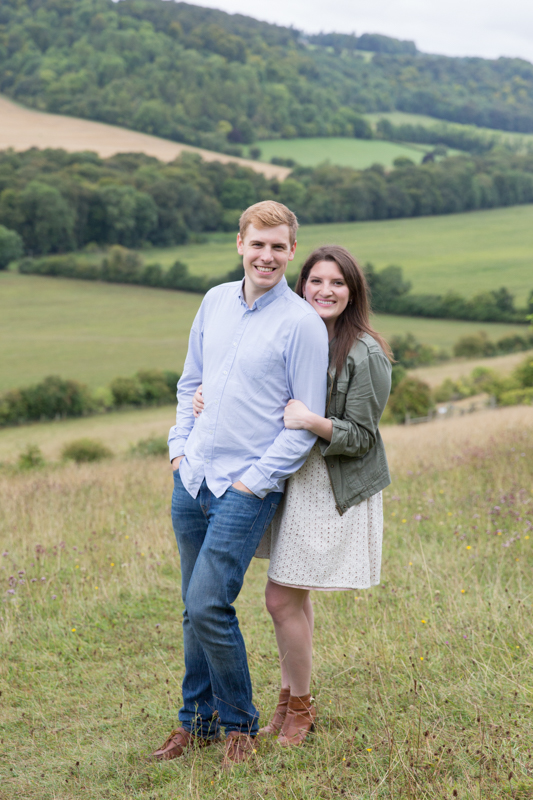 Couple looking happy on engagement shoot near Turville