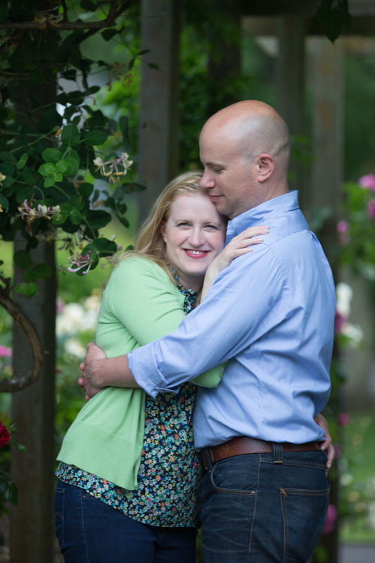 Couple looking happy on engagement shoot in Henley
