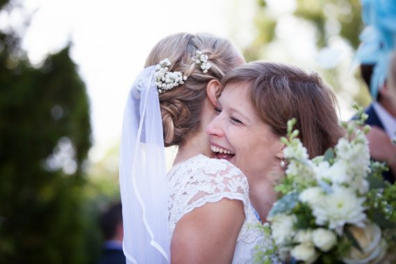 Bride being congratulated at her Stoke Park Wedding