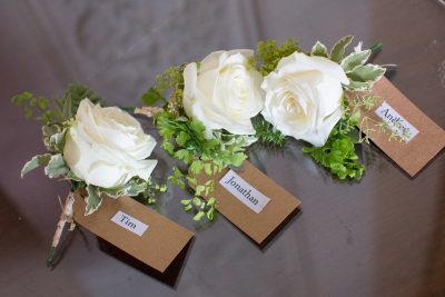 Button hole flowers at Stoke Park Wedding
