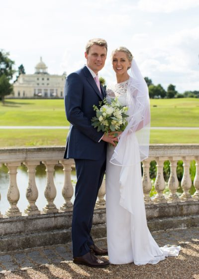 Bride and Groom with Stoke Park in the background