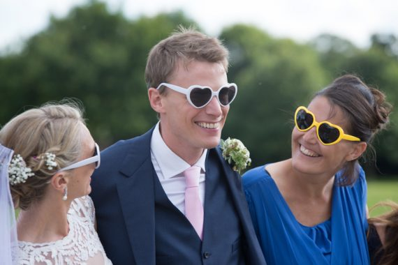 Groom wearing sunglasses at Stoke Park
