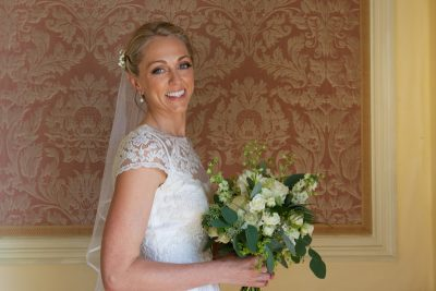 Bride with her bouquet at Stoke Park Wedding