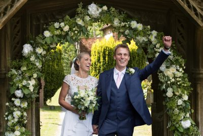 Bride and Groom looking happy at their Stoke Park wedding