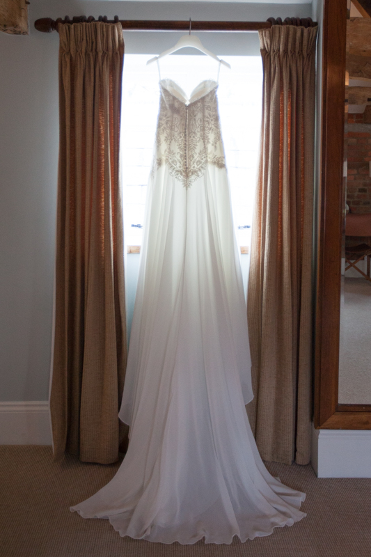 Wedding Dress hanging up in the bridal suite at Wasing Park