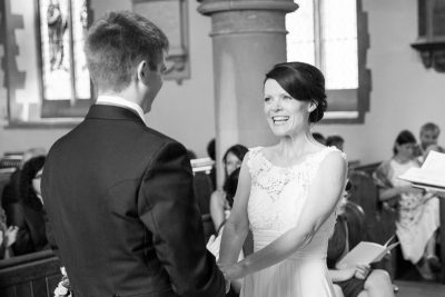 Bride smiling at her groom at St James Church Pangbourne
