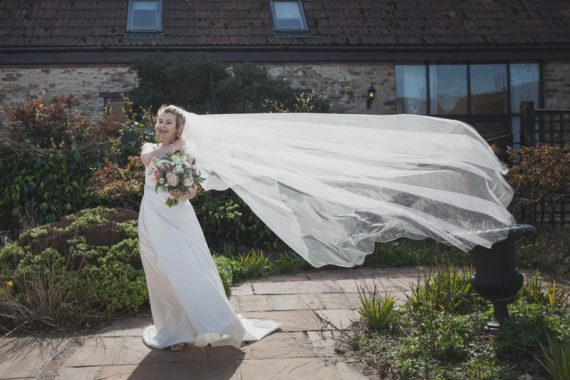 Bride's veil caught in wind at Crown and Thistle Wedding in Abingdon