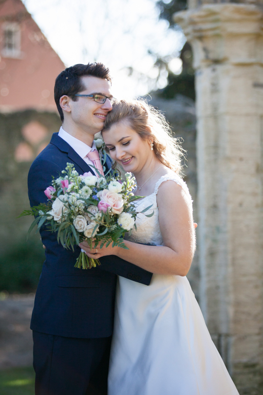 Bride and Groom romantic moment at Abingdon wedding