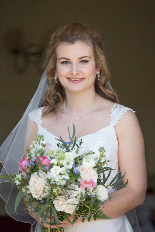 Bride with her bouquet at Crown and Thistle in Abingdon