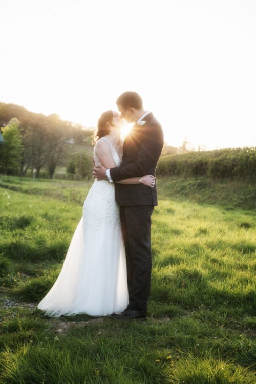 Bride and groom at sunset at Crown Inn Pishill