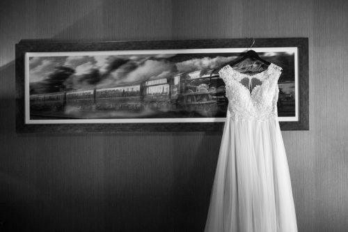 Wedding dress hanging up in GWR suite at Malmaison Hotel in Reading