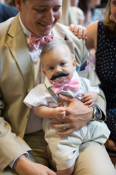 Cute baby guest at wedding in Shiplake College