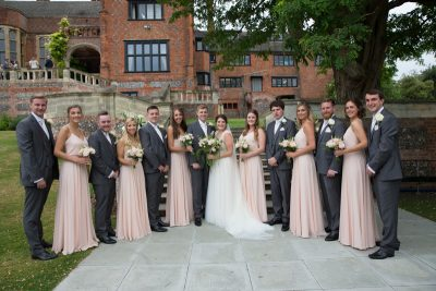 Large bridal party at Shiplake College wedding in Berkshire