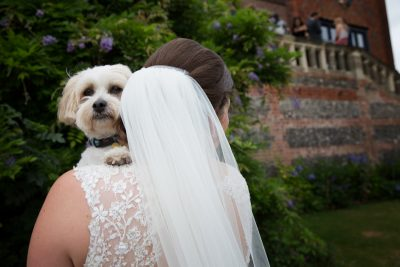 Bride with her dog at wedding at Shiplake College
