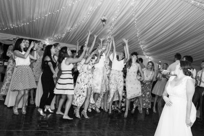 Bride tossing her bouquet at Shiplake College