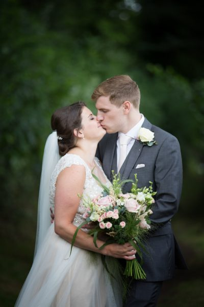 Bride and Groom kissing at their Shiplake College Wedding
