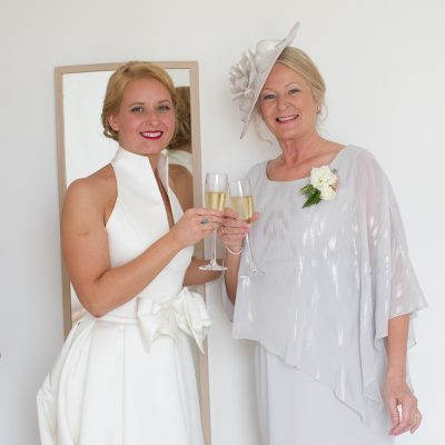 Bride and her Mum having glass of champagne