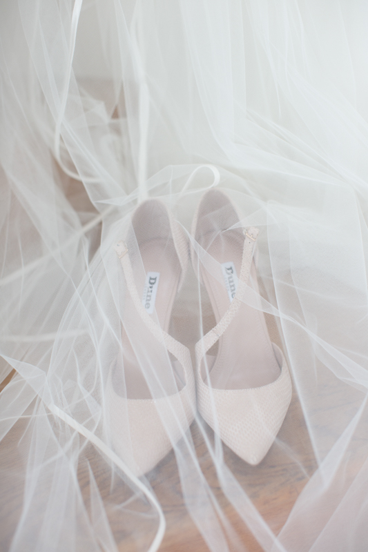 Wedding shoes under a veil