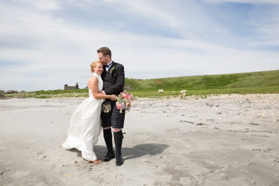 Bride and Groom portrait on beach at Crear