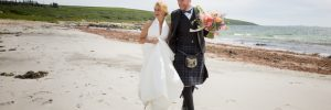 Bride and Groom smiling on the beach at their Crear Wedding