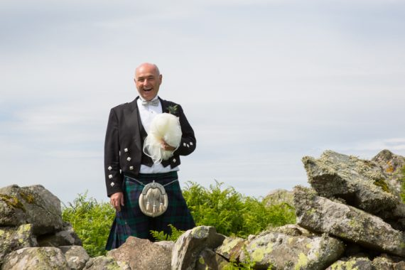 Man in kilt holding veil at Crear Wedding