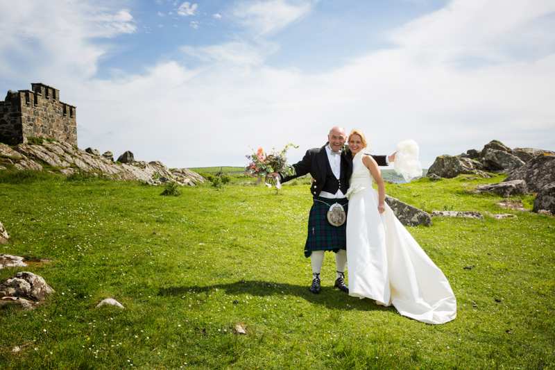 Bride and her father in happy mood at Crear in Scotland