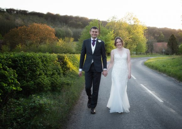 Couple walking near Crown Inn Pishill wedding