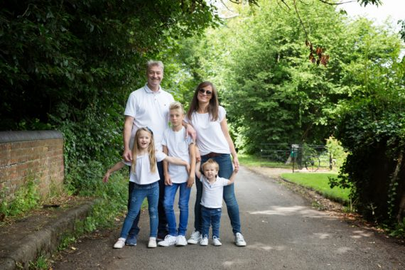 Family in woodlands on family photo shoot near Henley