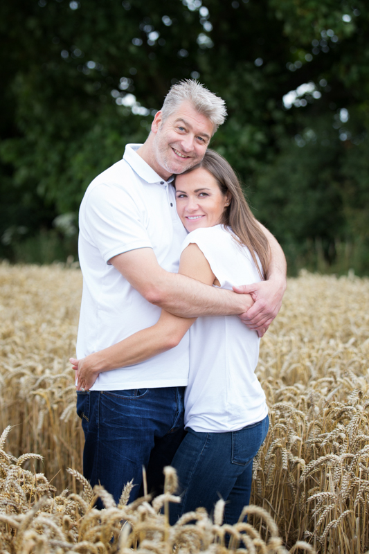 Couple in cornfield on their engagement shoot near Henley