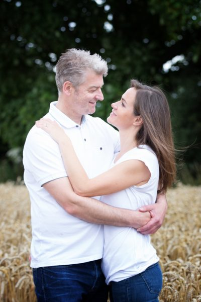 Couple in cornfield on their pre wedding shoot near Henley
