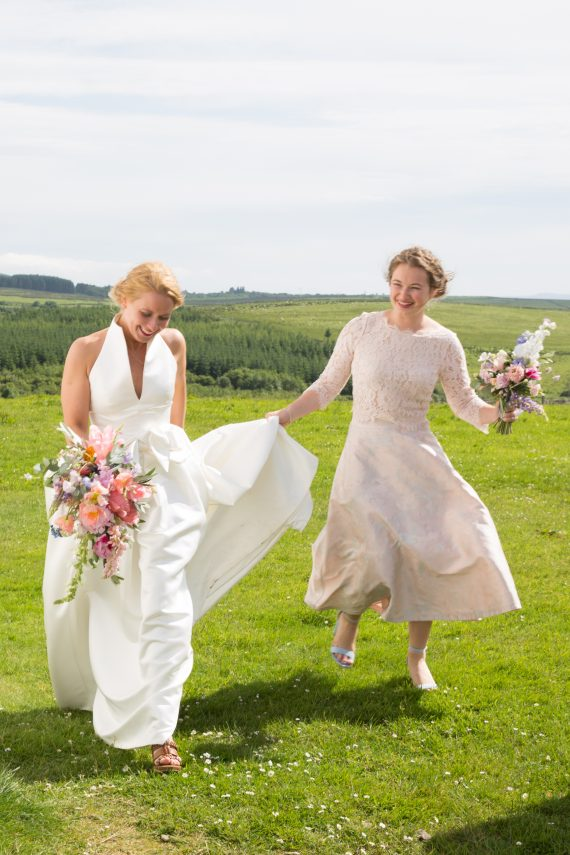 Bride walking with bridesmaid at Crear wedding