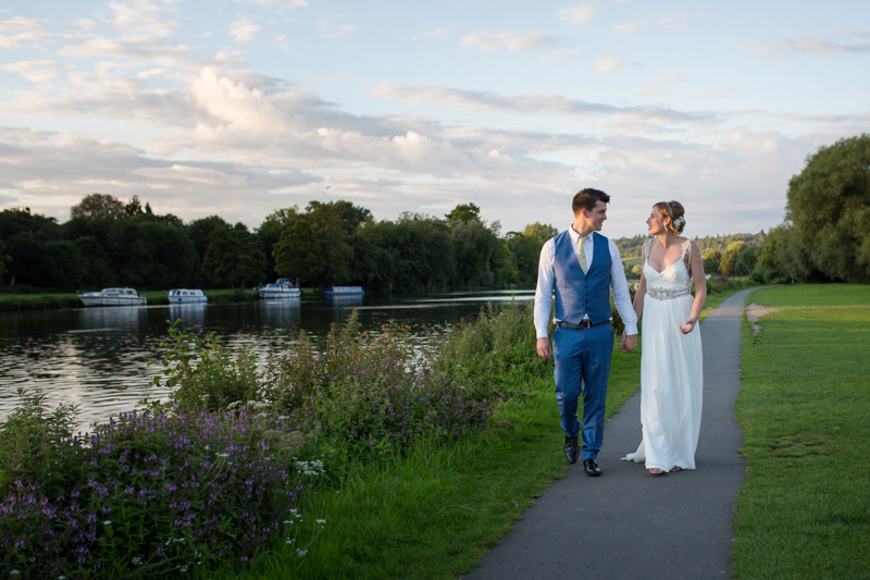 bride and groom by river in henley