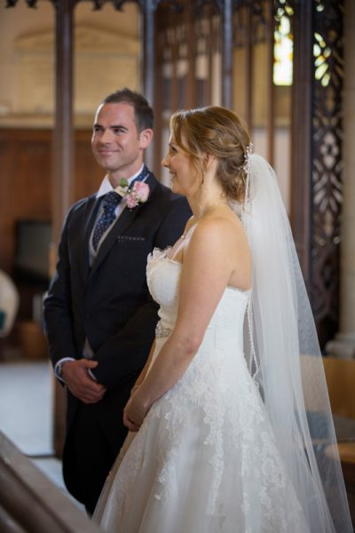 Bride and Groom looking happy at All Saints Church in Marlow