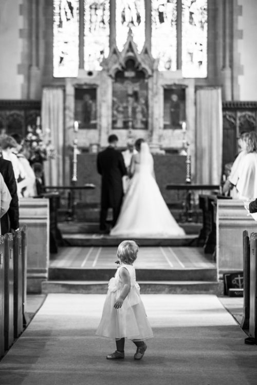 Flower girl fascinated at Marlow Wedding