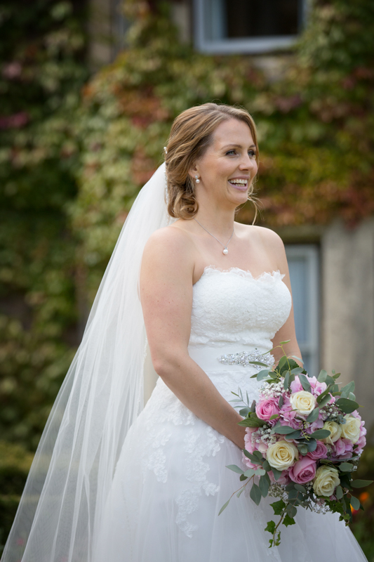 Bride looking happy at her Oakley Court Wedding