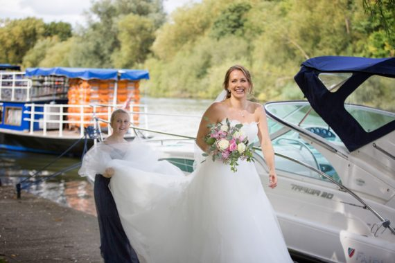 Bride walking along river at Oakley Court Wedding