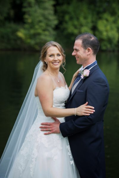 Bride and Groom looking happy at their Oakley Court Wedding