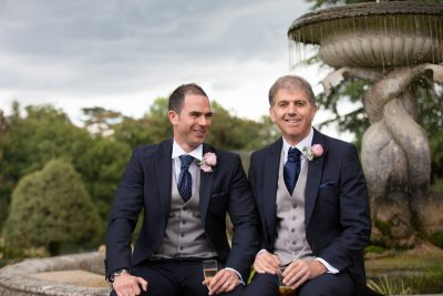 Groom and his father at wedding in Oakley Court Hotel