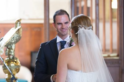 Groom looking at his bride in All Saints Church in Marlow