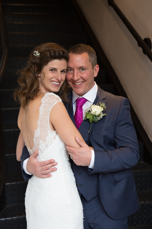 Bride and Groom looking happy in hotel du vin in Henley
