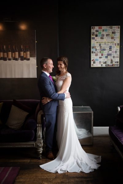 Bride and Groom in the reception area of Hotel du Vin in Henley