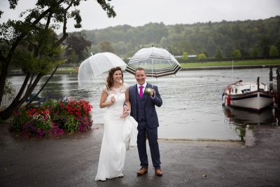Bride and Groom in the rain outside Hotel du Vin Henley