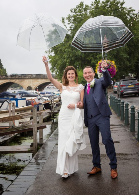 Bride and Groom near Henley Bridge in the rain