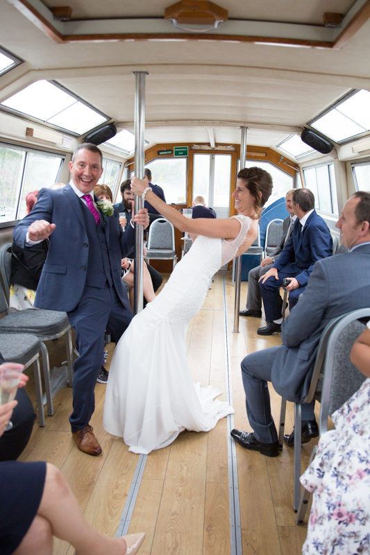 Bride and Groom dancing on a boat on the Thames