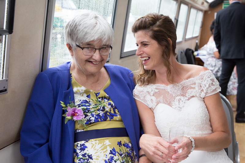 Bride and her Mum laughing on board Hobbs boat on Thames