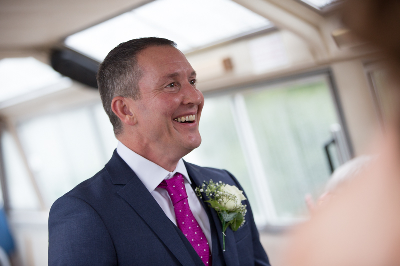 Groom on boat in the Thames at his wedding