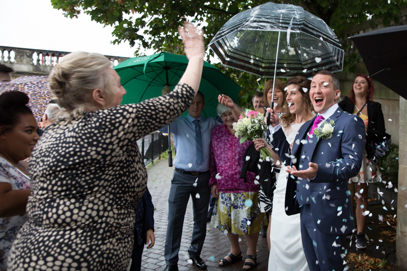 Bride and Groom with confetti near river at Henley on Thames