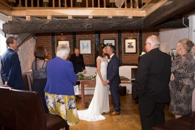 First kiss at civil ceremony at Hotel du Vin in Henley