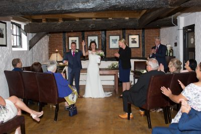 Bride and Groom cheering after getting married at Hotel du Vin in Henley